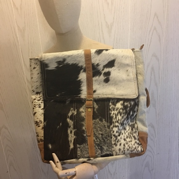 Myra Bag Bags Cowhide Backpack Poshmark Cowhide purse made by myra bag genuine leather and cowhide 3 pockets on the inside and a zipper to close cowhide backpack